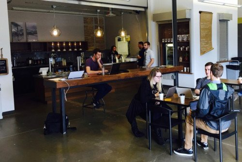 Kollective employees working at Stackhouse Coffee at the 1001 building.